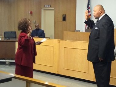 Flint Clerk Inez Brown swears in Kerry Nelson as a Flint city councilman in this 2015 Flint Journal file photo.