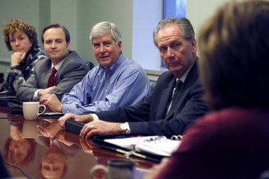 Snyder Chief of Staff Dennis Muchmore, right, is shown in this MLive file photo.