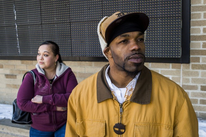 "Flint residents Jami Santee, left, and Dominique Fleming, both 33, stand together as they wait for a bus outside of the Mass Transportation Authority bus station on Friday, March 4, 2016 in downtown Flint. ""Flint is not a lost cause,"" Santee said. ""It's a landmark city, and everyone who lives here has lots of memories they don't want to see vanish. So many of us grew up here and want to stay here. We need to know how they plan to continue to fix Flint."""