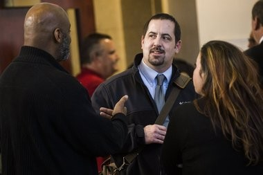 Mike Glasgow, Flint laboratory and water quality supervisor, speaks with Flint residents Arthur Woodson, left, and LeeAnne Walters during a meeting of Michigan's special Joint Committee on the Flint Water Public Health Emergency on Tuesday, March 29, 2016 at the Northbank Center in downtown Flint.