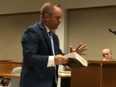 Special prosecutor Todd Flood speaks in Genesee District Court during a hearing Wednesday, Aug. 17.
