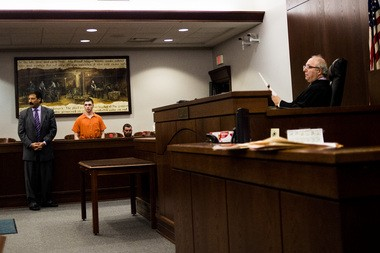 Ryan Stevens, 19, of Linden (in orange jumpsuit), stands before Genesee Circuit Judge Joseph Farah on Monday, Aug. 15, 2016.
