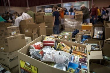 Donations are piled up in the MLive file photo.