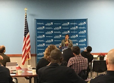 Flint Mayor Karen Weaver speaks at an event on Thursday, Dec. 15, showcasing projects that businesses in the Flint area worked on to improve lives in the city as part of the Flint Sprint initiative.