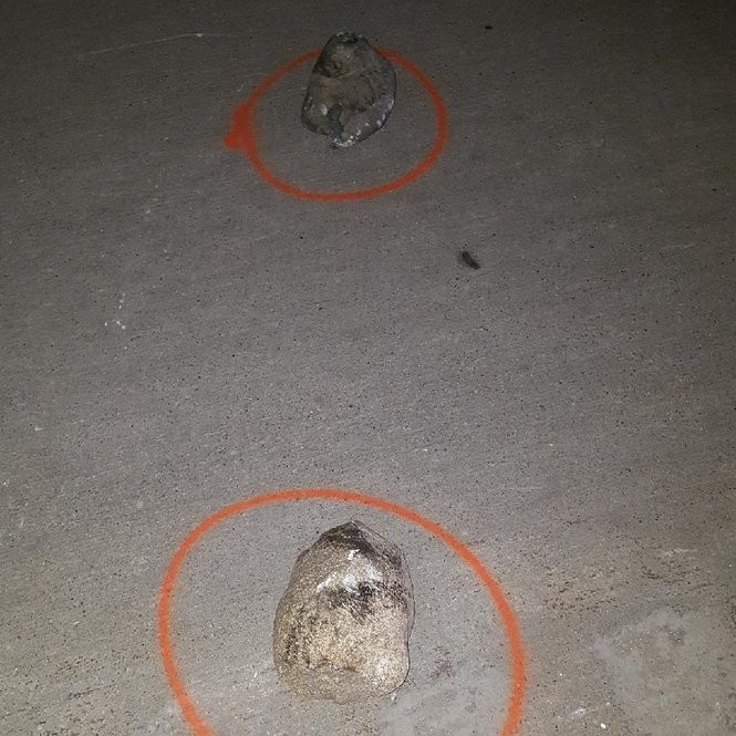 This photo provided by the Genesee County Sheriff's Office show two rocks found at the scene of a fatal crash in Vienna Township on Wednesday, Oct. 18. Police believe someone threw a rock off of an overpass, striking a 32-year-old Mt. Morris' man's vehicle. The man later died at the hospital.