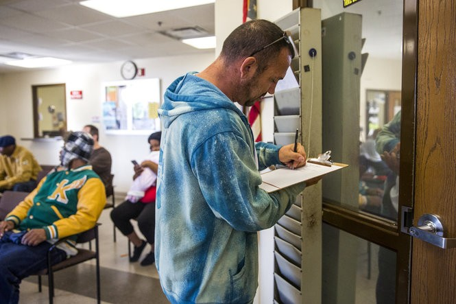 "Scott Daup checks in for a probation appointment on Tuesday, Oct. 17, 2017, in downtown Flint. He avoided arrest for years while using heroin and other drugs. Now he says he's ""grateful"" for the felony charges that landed him in drug court. ""They helped guide me to where I'm at today,"" he said. ""It takes whatever it takes."" Terray Sylvester 