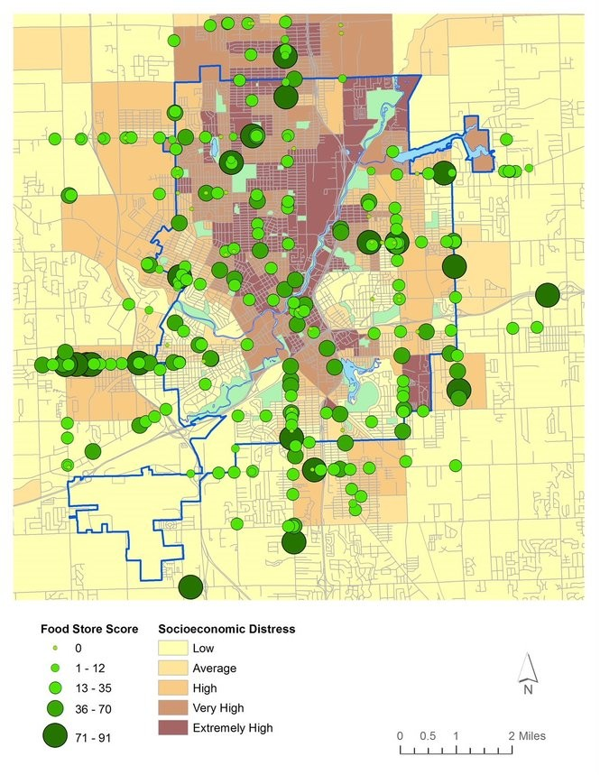 "A map shows all food retailers in Flint compared to zones of socioeconomic distress. A food store score of 50 or higher is considered a ""good"" food option, Sadler said."
