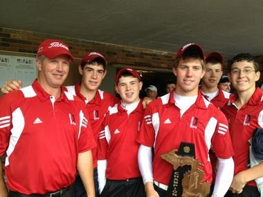 The Swartz Creek golf team celebrates with the district trophy after winning last Friday's district tournament at Davison Country Club. - 2012(Ross Maghielse | MLive.com file photo)