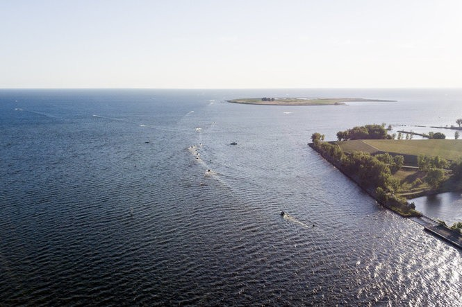 Fishermen file out onto the Saginaw Bay before heading their separate ways to fish and compete in the National Walleye Tour tournament's Saginaw Bay stop on June 14, 2018.