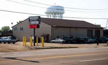 "Ryan Garza | The Flint Journal Spooner Metals, located on Dort Highway, was alleged to be the source of a loud ""explosion"" on the east side of Flint. Resident have reported hearing these loud booms on a regular basis."
