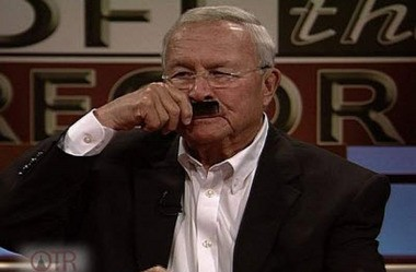 "Oakland County Executive Brooks Patterson uses a comb to make a comparison between House Speaker Jase Bolger and Adolph Hitler during a recent taping of WKAR's ""Off the Record"" program. Tom Ivacko argues that a Michigan survey shows that hostile political rhetoric damages trust in government. (courtesy photo/WKAR)"
