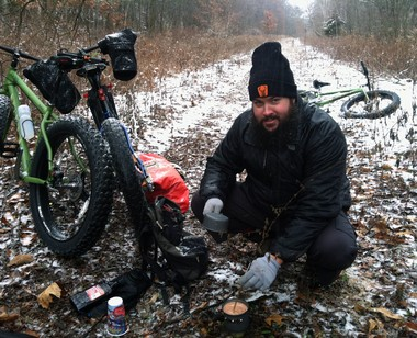 Ted Bentley, of Lowell, prepares a hot drink on a recent winter bike camping trip he took near Greenville in preparation for the 2014 Arrowhead 135 race, which begins in International Falls, Minnesota.