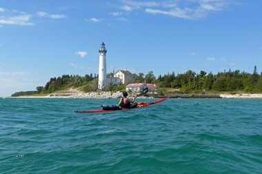Mequon, Wisconsin paddler Mary Braband explores the waters off South Manitou Island on Lake Michigan.
