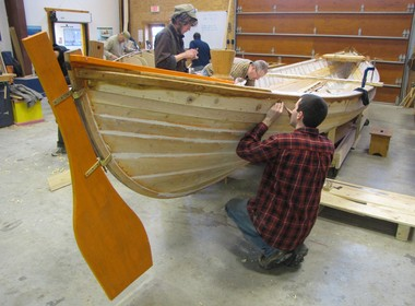 Great Lakes Boat Building School students work on one of seven authentic whaleboat replicas that will launch with the Charles W. Morgan this summer.