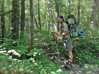 Luke Jordan pauses while hiking the 4,600 mile North Country Trail.