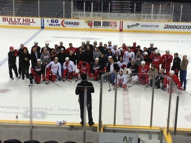 The Red Wings took a group photo with their fathers/mentors after practice Monday in Nashville.