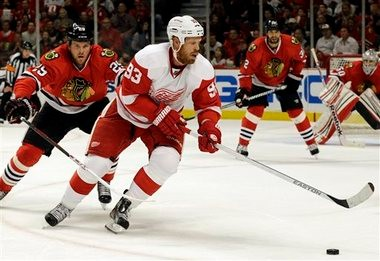 Johan Franzen (right), being chased by Chicago's Bryan Bickell, has just six points in 14 playoff games.