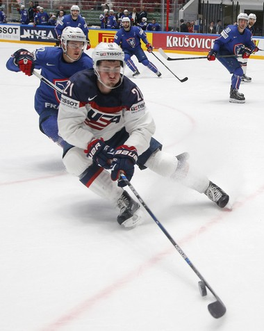 The Red Wings' Dylan Larkin, playing for the U.S., battles France's Jordann Perret for the puck at the World Championship.