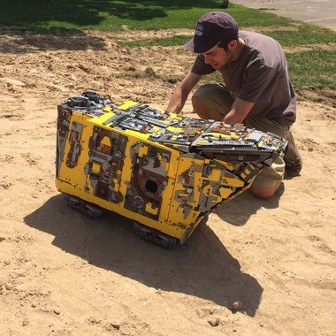 Jarren Harkema tries out the LEGO Sandcrawler in Morley Park's sand piles