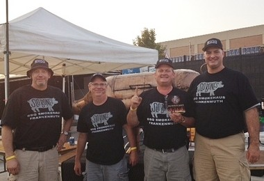 With Pork Chop in the background, the crew from Slo' Bones shows off its People's Choice Award from Saginaw's Rock 'n Rib Fest held Aug. 9, 2014. (courtesy photo)