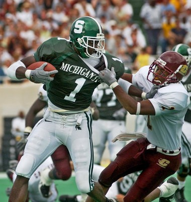 Michigan State receiver Charles Rogers tries to break free from the grasp of Central Michigan defender Tedaro France after catching a pass in the second quarter of the Spartan's 35-21 win in East Lansing.