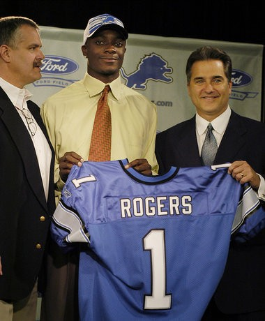Detroit Lions president and chief executive officer Matt Millen, left, and Lions head coach Steve Mariucci, right, pose with Charles Rogers, the team's first round draft choice, during a press conference on Sunday, April 27, 2003 at the Lions practice facility in Allen Park, Mich.