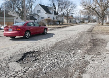 Long-term road repair funding is left unresolved in Michigan's new state budget plan.