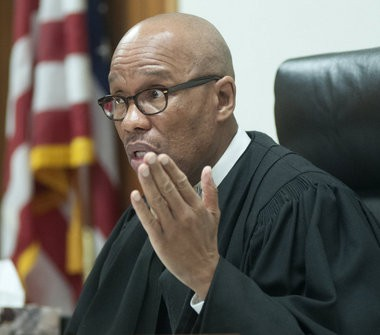 Saginaw County District Judge Terry L. Clark discusses a prosecution motion to close his courtroom to the public during Michael Lawrence's preliminary hearing.
