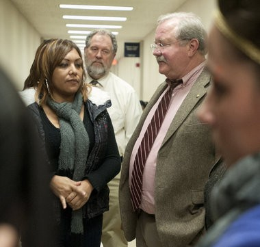 Saginaw County Chief Assistant Prosecutor Christopher Boyd, right, talks with Theresa Medel, the mother of Angelica Olivarez, after the continuance of Michael D. Lawrence's preliminary hearing.