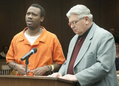 Michael D. Lawrence, 24, addresses Saginaw County Circuit Judge Darnell Jackson as his defense attorney William White listens during Lawrence's Feb. 27, 2014, sentencing.