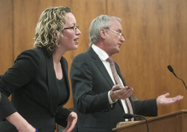 Wendy S. Leeck's defense attorney James Gust, right, argues with Saginaw County Assistant Prosecutor Jennifer Barnes during Leeck's Feb. 28, 2014, preliminary hearing in front of Saginaw County District Judge M. Randall Jurrens.