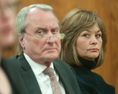 Wendy S. Leeck and her attorney James Gust listen to testimony during Leeck's Feb. 28, 2014, preliminary hearing in front of Saginaw County District Judge M. Randall Jurrens.