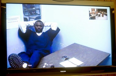 Michael D. Lawrence, via video from a prison in Jackson, waits for the start of his March 31, 2014, pre-trial motion hearing in front of Saginaw County Circuit Judge Darnell Jackson.