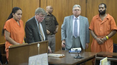 From left, Mio Campbell, her attorney George C. Bush, attorney William White, and his client Aki C. Dillard stand as Saginaw County District Judge Terry L. Clark enters the courtroom for a the couple's April 9, 2014, preliminary hearing.