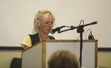 Tamyra Murray speaks to community members at Vassar High School, 220 Athletic Street in Vassar, Wednesday, July 9, 2014.
