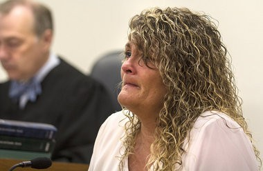 Michelle Berk, mother of Jessica Callan, attempts to hold back tears while testifying during the July 17, 2014, preliminary hearing for Birl L. Hill in connection with the July 2010 homicide of the 23-year-old Callan.