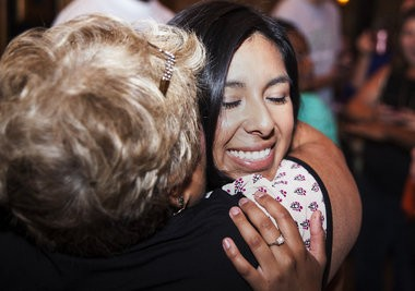 Bridgeport native Vanessa Guerra, 24, hugs a supporter after winning the Democratic primary in the 95th State House race, defeating Norman Braddock. Guerra gathered with supporters inside Mac's at 118 North Michigan in Saginaw, Tuesday, Aug. 5, 2014.