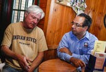 "Neil Barris | Mlive.com John ""Gonzo"" Gonzalez talks with owner Mike Hanley at Big Ugly Fish, 1418 State in Saginaw, Wednesday, Sept. 17, 2014. Big Ugly Fish is in the running for Michigan Best Neighborhood Bar contest."