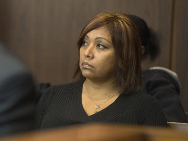 Theresa Medel, the mother of Angelica Olivarez, listens to arguments during an Oct. 15, 2014, motion hearing for Michael D. Lawrence before the start of Lawrence's trial in front of Saginaw County Circuit Judge Darnell Jackson.