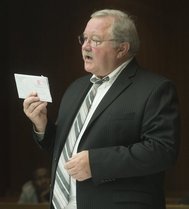 Saginaw County Chief Assistant Prosecutor Christopher Boyd, right, displays an envelope that Michael D. Lawrence attempted to send to his 5-year-old son as Boyd argues a point during an Oct. 15, 2014, motion hearing before the start of Lawrence's trial in front of Saginaw County Circuit Judge Darnell Jackson.