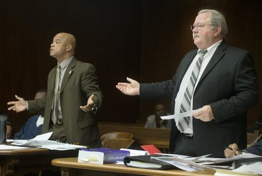 Saginaw County Chief Assistant Prosecutor Christopher Boyd, right, and Michael D. Lawrence's attorney Edwin Johnson III, left, argue a point during an Oct. 15, 2014, motion hearing before the start of Lawrence's trial in front of Saginaw County Circuit Judge Darnell Jackson.