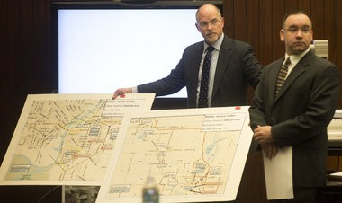 Saginaw County Assistant Prosecutor Paul Fehrman, left, and Michigan State Police Trooper Neil Somers display diagrams showing where cellphone calls were made during the trial for Birl L. Hill in front of Saginaw County Circuit Judge Darnell Jackson on Dec. 12, 2014.