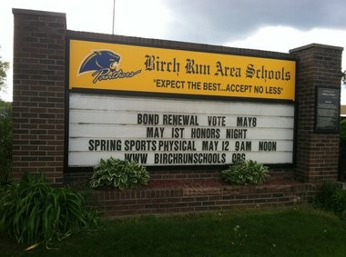 The sign outside of Birch Run High School reminds voters of the election on Tuesday.