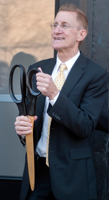 David Strouse, owner of the Strouse Hamilton Apartment building on South Hamilton and Van Buren in Old Saginaw City, used a huge pair of scissors during his ribbon-cutting ceremony. Strouse gutted the old building and remodeled it into new apartments.