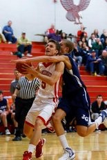 Zachary Scherzer takes it to the hoop for Frankenmuth High School.