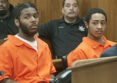 Demarkus R. Bowes, left, and Elmer T. Curry III listen to testimony during their April preliminary hearing in connection with the Feb. 26 beating death of Gregory Gross.