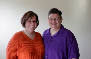 In this March 5, 2013, file photo, April DeBoer, left, and Jayne Rowse, and pose at their home in Hazel Park, Mich.