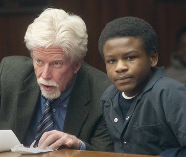 "Carl ""Lil Carl"" Howard, 14, and his attorney James Tiderington wait for the start of his Feb. 20, 2014, sentencing hearing in front of Saginaw County Circuit Judge James T. Borchard."