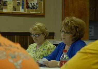 Village of Oakley President Pro Tem Sue Dingo, right, and clerk Cheryl Bolf at the June 10 village meeting.