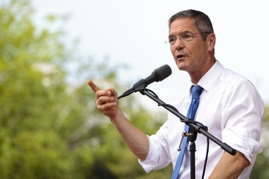 Then-gubernatorial candidate Mark Schauer speaks at a Democratic rally at Rosa Parks Circle in Grand Rapids on July 27, 2014.